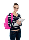 Beautiful smiling college student writing notes Royalty Free Stock Photography