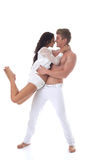 Beautiful smiling couple dancing in studio Royalty Free Stock Photos