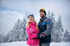 Beautiful smiling couple enjoying in winter vacations Stock Photos