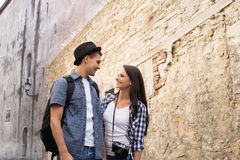 Beautiful, smiling couple having a pleasant walk in old town Stock Photography