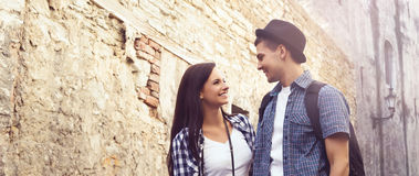Beautiful, smiling couple having a pleasant walk in old town. Stock Photos