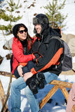 Beautiful smiling couple hugging and smiling in the winter mountain Stock Photo