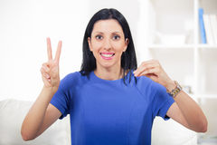 Beautiful smiling deaf woman using sign language Stock Images