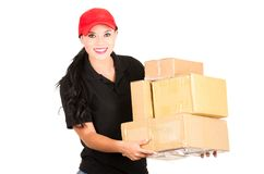 Beautiful smiling delivery girl holding packages Stock Photography
