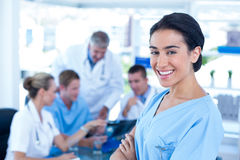 Beautiful smiling doctor looking at camera Stock Images