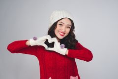 Beautiful smiling fashion model face with red lips in warm cloth. Ing gesture heart shape royalty free stock image