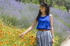 Beautiful smiling fashion woman portrait in a lavander garden Royalty Free Stock Images