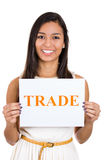 Beautiful smiling female holding a sign which says: trade Royalty Free Stock Photos