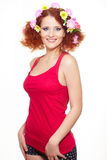 Beautiful smiling ginger woman in red cloth Royalty Free Stock Photo