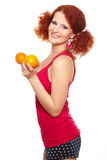 Beautiful smiling ginger woman in red cloth Royalty Free Stock Image