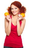 Beautiful smiling ginger woman in red cloth Royalty Free Stock Photos