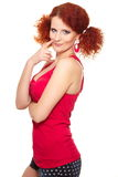 Beautiful smiling ginger woman in red cloth Stock Photo