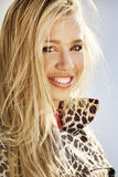 Beautiful smiling girl. Beautiful smiling blond girl outdoors royalty free stock images