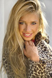 Beautiful smiling girl. Beautiful smiling blond girl outdoors Stock Images