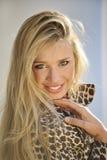 Beautiful smiling girl. Beautiful smiling blond girl outdoors Stock Image