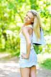Beautiful smiling girl. Young beautiful smiling girl - outdoors royalty free stock image