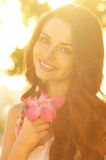 Beautiful smiling girl. Portrait of beautiful smiling girl holding flower. soft light photo Royalty Free Stock Image