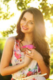 Beautiful smiling girl. Against spring green bokeh background Royalty Free Stock Photography