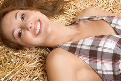 Beautiful Smiling Girl. In hay Stock Images
