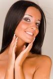Beautiful smiling girl. Beautiful brunet smiling girl, studio shot stock photo