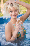 Beautiful smiling girl. In Jacuzzi stock image