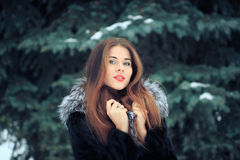Beautiful smiling girl on background of snowy Stock Photos