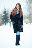 Beautiful smiling girl on background of snowy Royalty Free Stock Photos