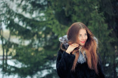 Beautiful smiling girl on background of snowy Stock Image