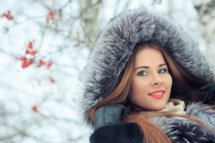 Beautiful smiling girl on background of snowy Stock Images