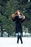 Beautiful smiling girl on background of snowy Royalty Free Stock Photography