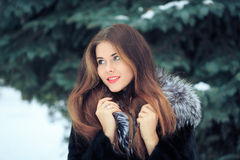 Beautiful smiling girl on background of snowy Royalty Free Stock Photo