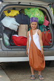Beautiful smiling girl with bag. Beautiful smiling girl with brown bag and suitcases in car Royalty Free Stock Image