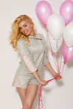 Beautiful smiling girl with balloons on a white background Royalty Free Stock Photography