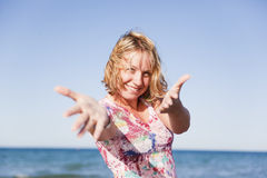 Beautiful smiling girl on the beach Stock Photos