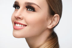 Beautiful Smiling Girl With Beauty Makeup And Long Eyelashes. Fake Eyelashes. Portrait Of Beautiful Sexy Woman With Professional Makeup And Smooth Soft Skin Stock Images