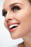 Beautiful Smiling Girl With Beauty Makeup And Long Eyelashes Royalty Free Stock Photography