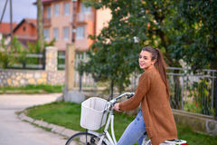 Beautiful smiling girl with a bicycle Stock Images