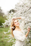 Beautiful smiling girl in  blossom garden on a spring day Stock Photos