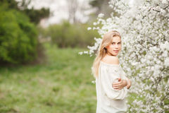 Beautiful smiling girl in  blossom garden on a spring day Stock Photo