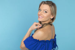 Beautiful smiling girl in a blue dress Stock Photography