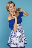 Beautiful smiling girl in a blue dress Stock Photos