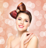 Beautiful smiling girl with a bow haircut and colorful make-up Royalty Free Stock Image