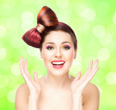 Beautiful smiling girl with a bow haircut and colorful make-up Stock Photography