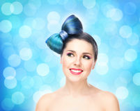 Beautiful smiling girl with a bow haircut and colorful make-up on bubble background Royalty Free Stock Photography