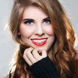 Beautiful smiling girl with braces. On a gray background Stock Images