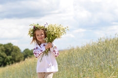 Beautiful smiling girl with bunch of wild flowers Royalty Free Stock Images