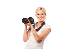 Beautiful smiling girl with camera Stock Photography