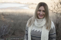 Beautiful smiling girl in cardigan and white scarf Royalty Free Stock Photos
