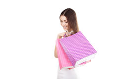Beautiful smiling girl carrying colorful shopping bags Stock Photos