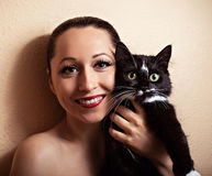 Beautiful smiling girl with cat Stock Photo